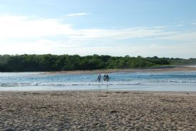 Crossing the estuary to catch surf - Playa Langosta, Guanacaste
