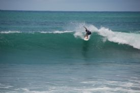 Costa Rican Surfer Droping into nice wave at Backwash Break in Matapalo