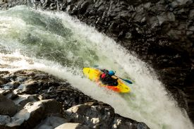 White water kayaking over a waterfall on the Pascua section of the Reventazon River - Turrialba, Cartago