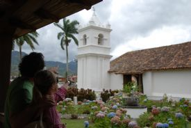 Tourists admiring the beautiful  Orosi Church - Orosi, Cartago