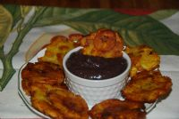 Amazing fried Patacones served with black beans