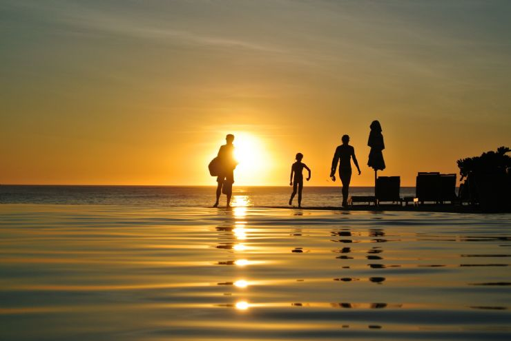 Family having fun with breathtaking sunset at JW Marriott Guanacaste