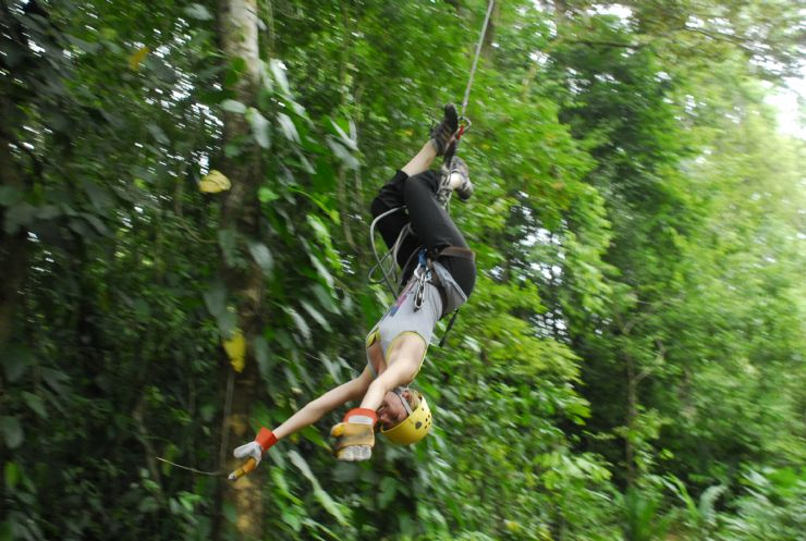 Swinging upside-down on a Canopy Tour at Colinas del Poás, Costa Rica