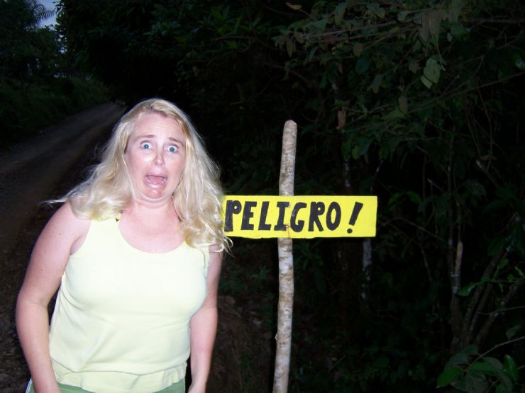 Scared Tourist next to a Danger sign