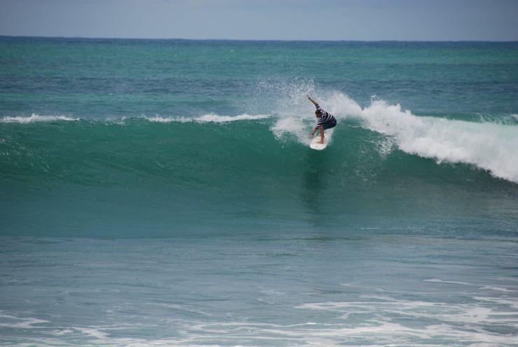 Dropping in good wave backwash Matapalo