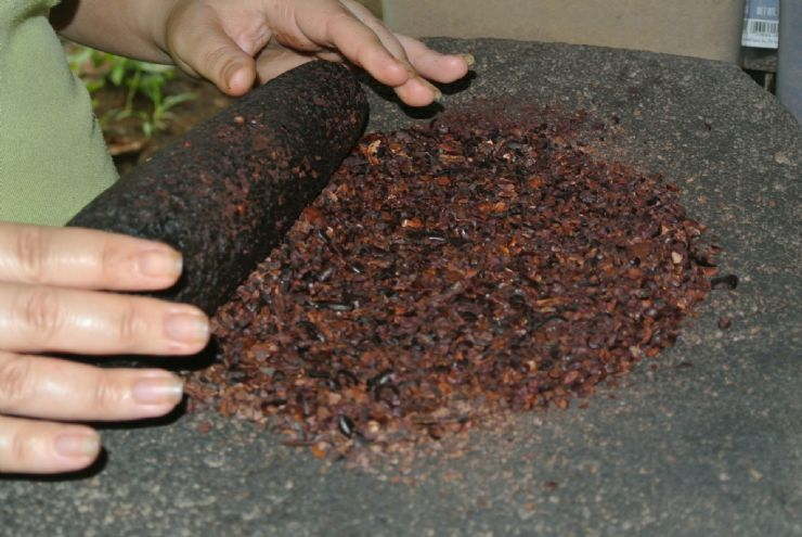 Cacao grinding before sugar added