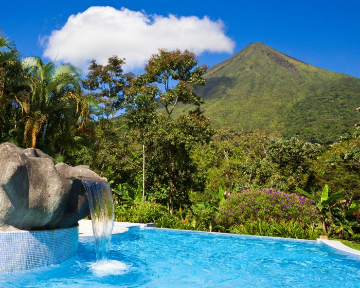 Beautiful pool at a hotel with a view of Arenal Volcano