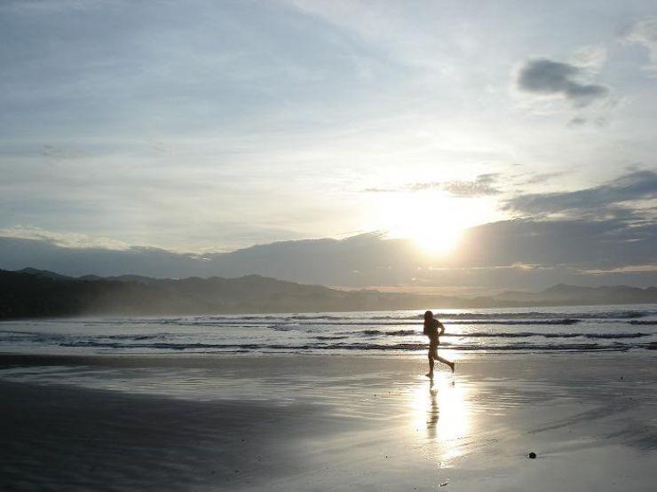 Jogging alone at Playa Samara