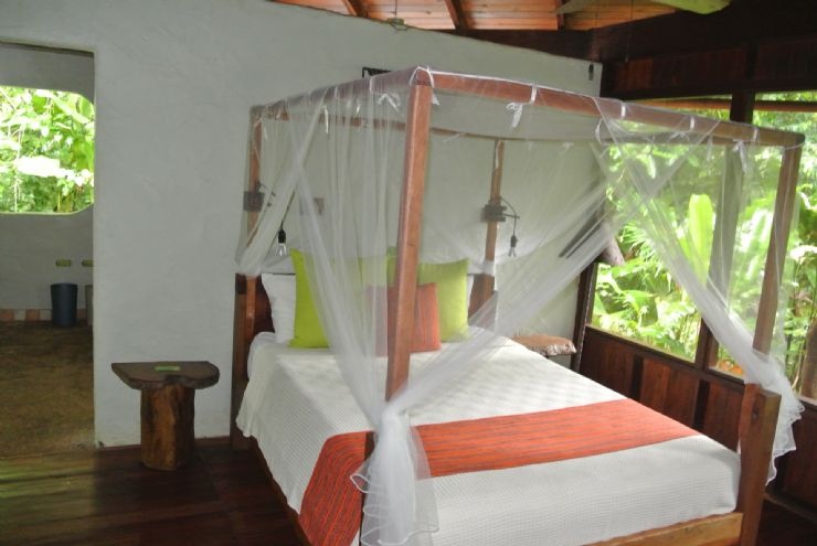Playa Nicuesa rainforest Lodge beautiful room Bed