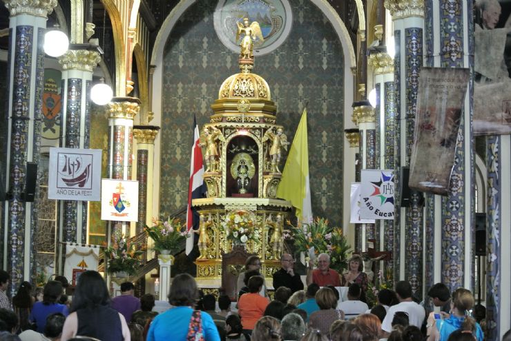 People praying inside Cartago's Church in Costa Rica