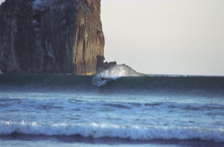 Surfer catching a wave at Witches Rock