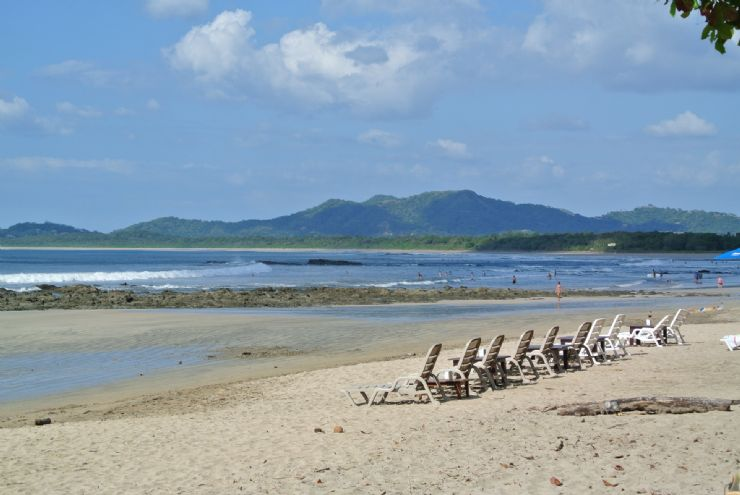 Tamarindo beach chairs waiting for you