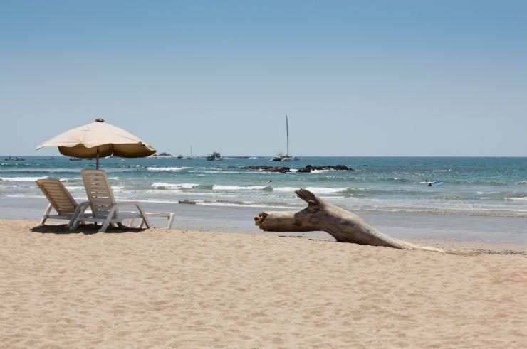 Chairs & umbrella on a empty beach in Tamarindo