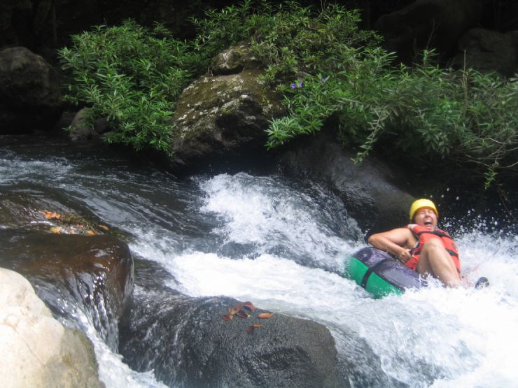 Happy while white water tubing on the Rio Negro, Costa Rica