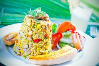 Travelers could rediscover their love of Arroz Con Pollo in Costa Rica
