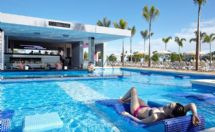 Relax at the pool at Hotel Riu Palace Costa Rica