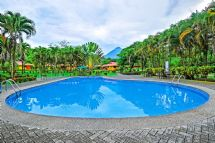 Hotel pool with Arenal Volcano