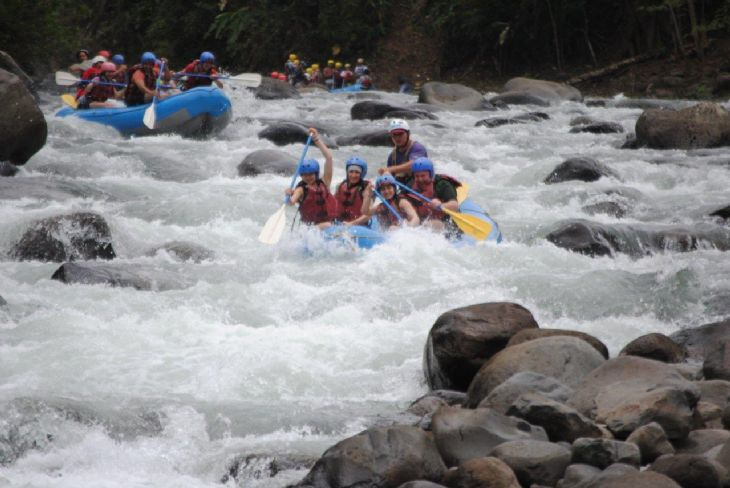 Rafting group in the wild river